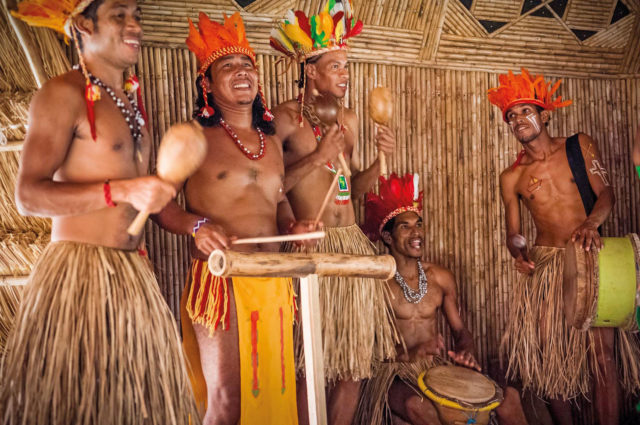 A cultural performance is one of the highlights of a visit to Dominica's Kalinago Barana Autê. Photo by Hemis/Alamy Stock Photo
