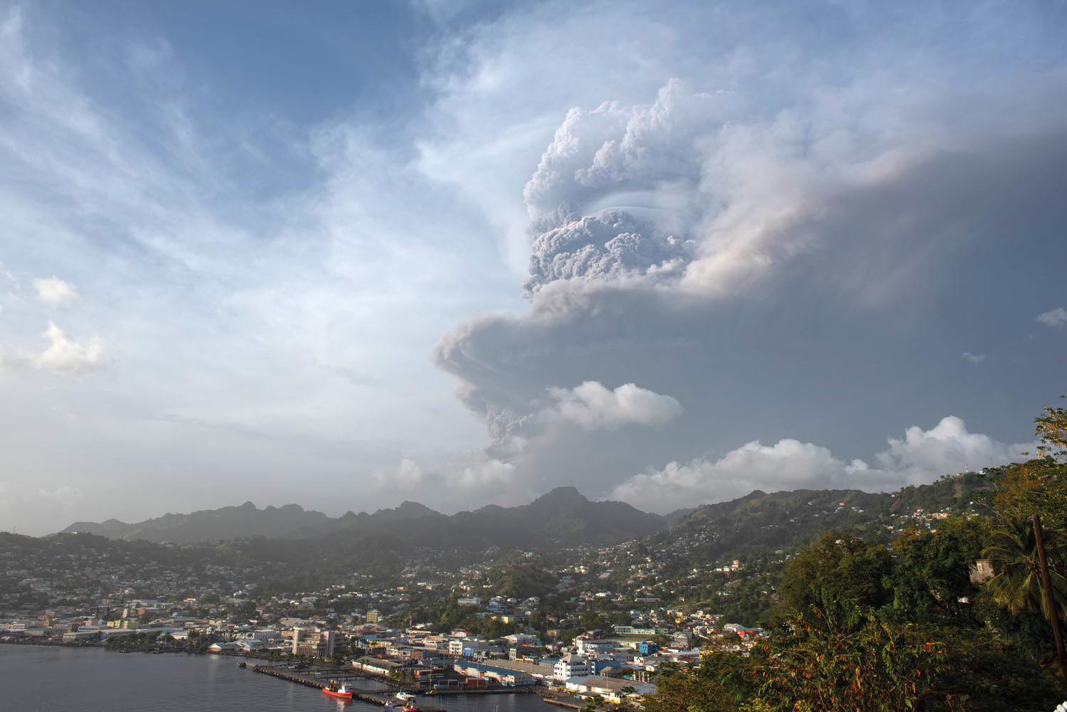 Ash cloud visible over Kingstown. Photo by Stephan Hornsey