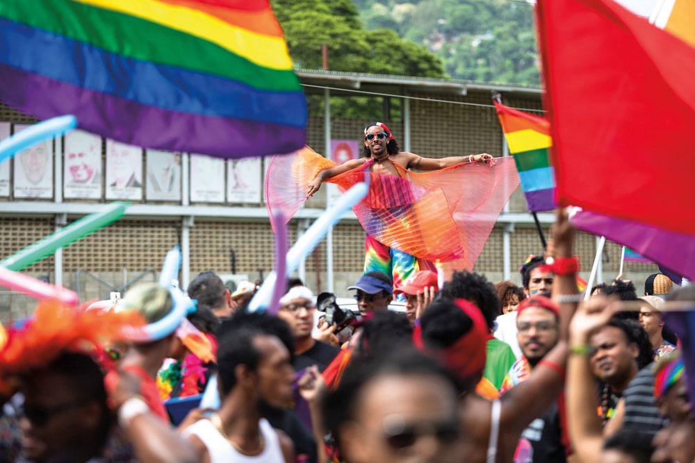 Rainbow flags fly high at T&T's first-ever Pride Parade in 2018. Photo by Maria Nunes