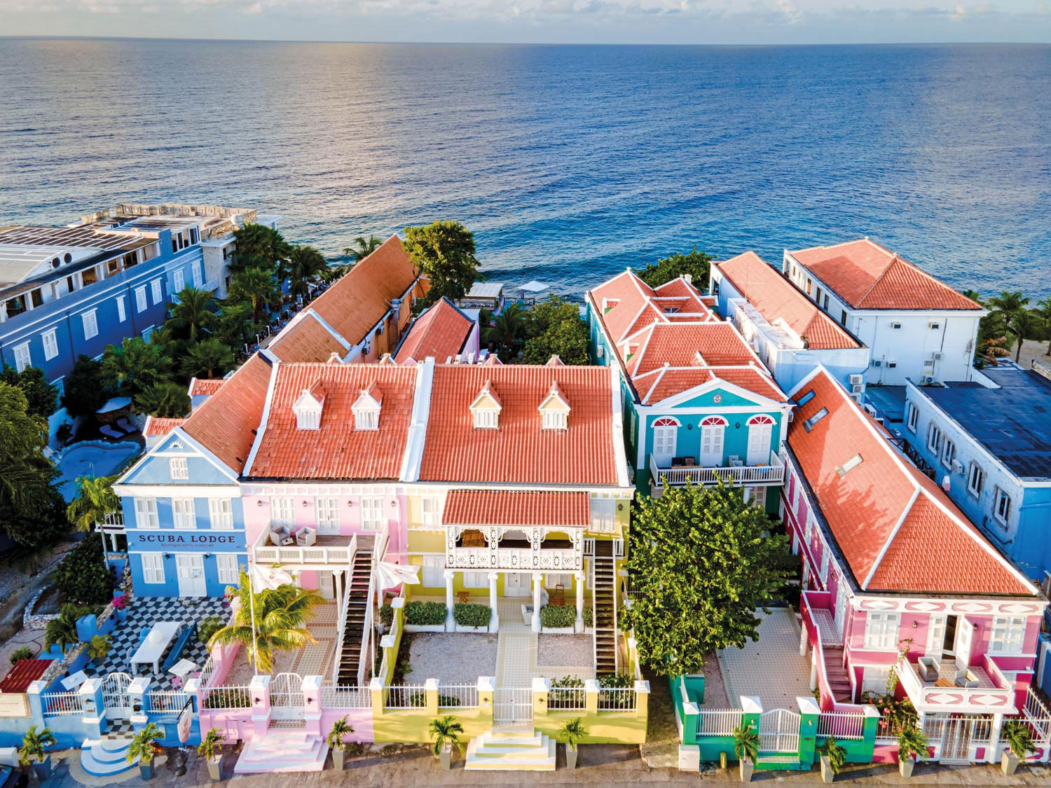 East of central Willemstad, the neighbourhood of Pietermaii is full of colourful historic houses converted into boutique hotels. Photo by Baarssen Fokke/Alamy Stock Photo