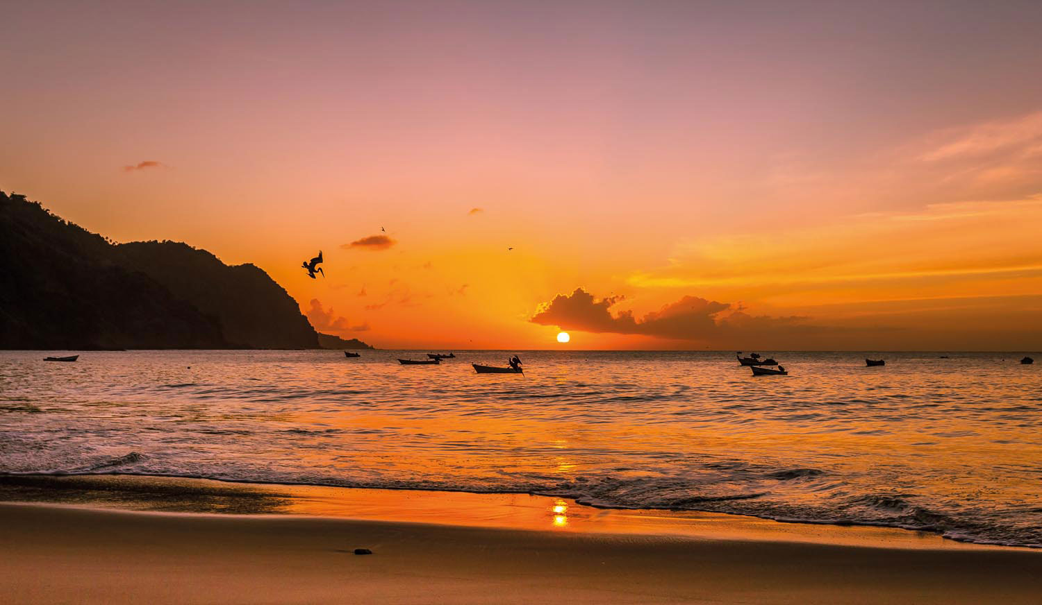 The sun sets at the end of another romantic day at Castara Bay, Tobago. Photo by Coatesy/Shutterstock.com
