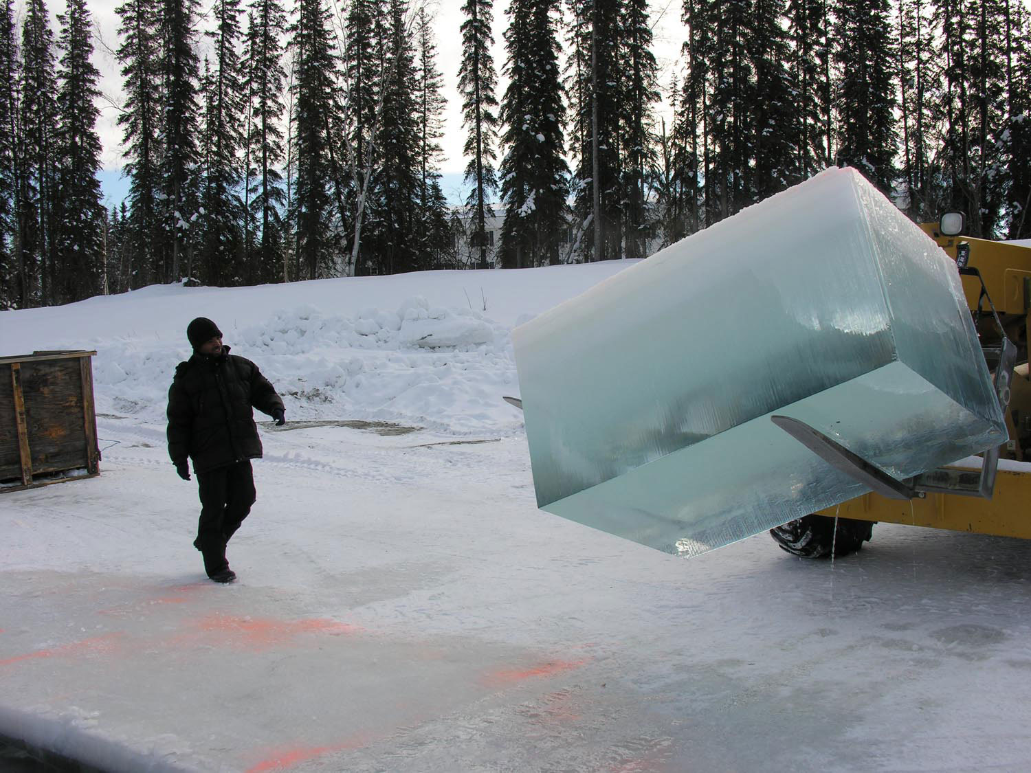 Excavating the ice block from a frozen river in Alaska. Photo by Chris Hoover, courtesy the artist