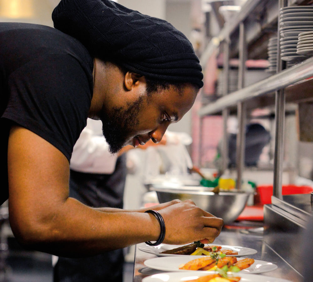 Jamaican chef Troy Levy plates one of his dishes at the 2018 Caribbean Holiday Guest Chef Series at United Nations headquarters in New York City. Photo courtesy Caribbean Holiday Guest Chef Series