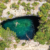 Swimming in a blue hole in Grand Bahama Island. Photograph by The Bahamas Ministry of Tourism and Aviation