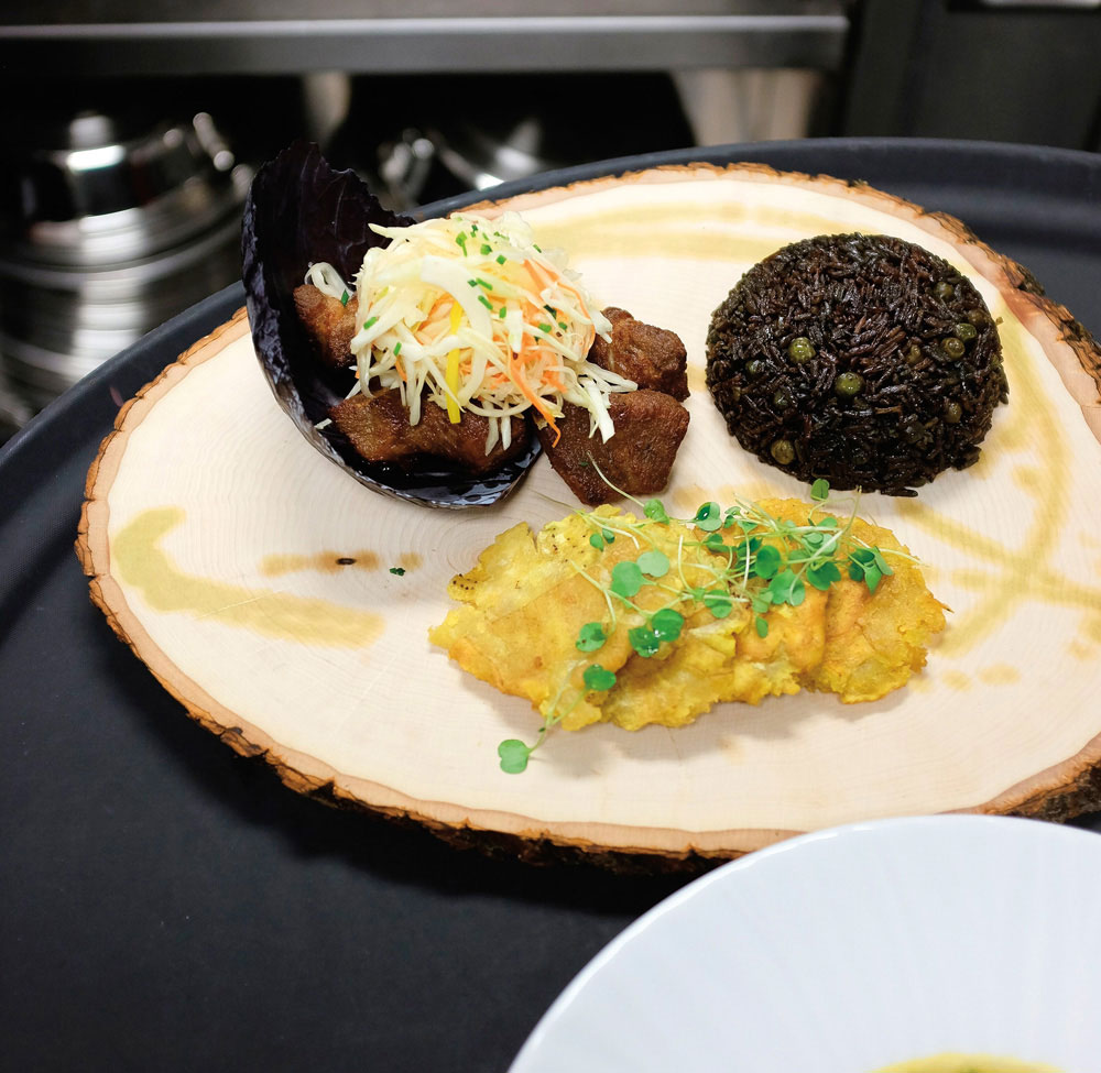 Haitian griot pork with black mushroom rice. Photo courtesy Caribbean Holiday Guest Chef Series