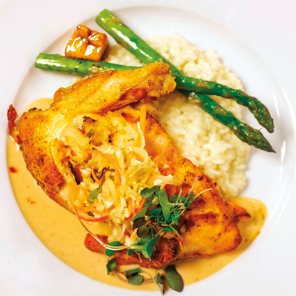 Bahamian chicken with a peas and rice risotto. Photo courtesy Caribbean Holiday Guest Chef Series