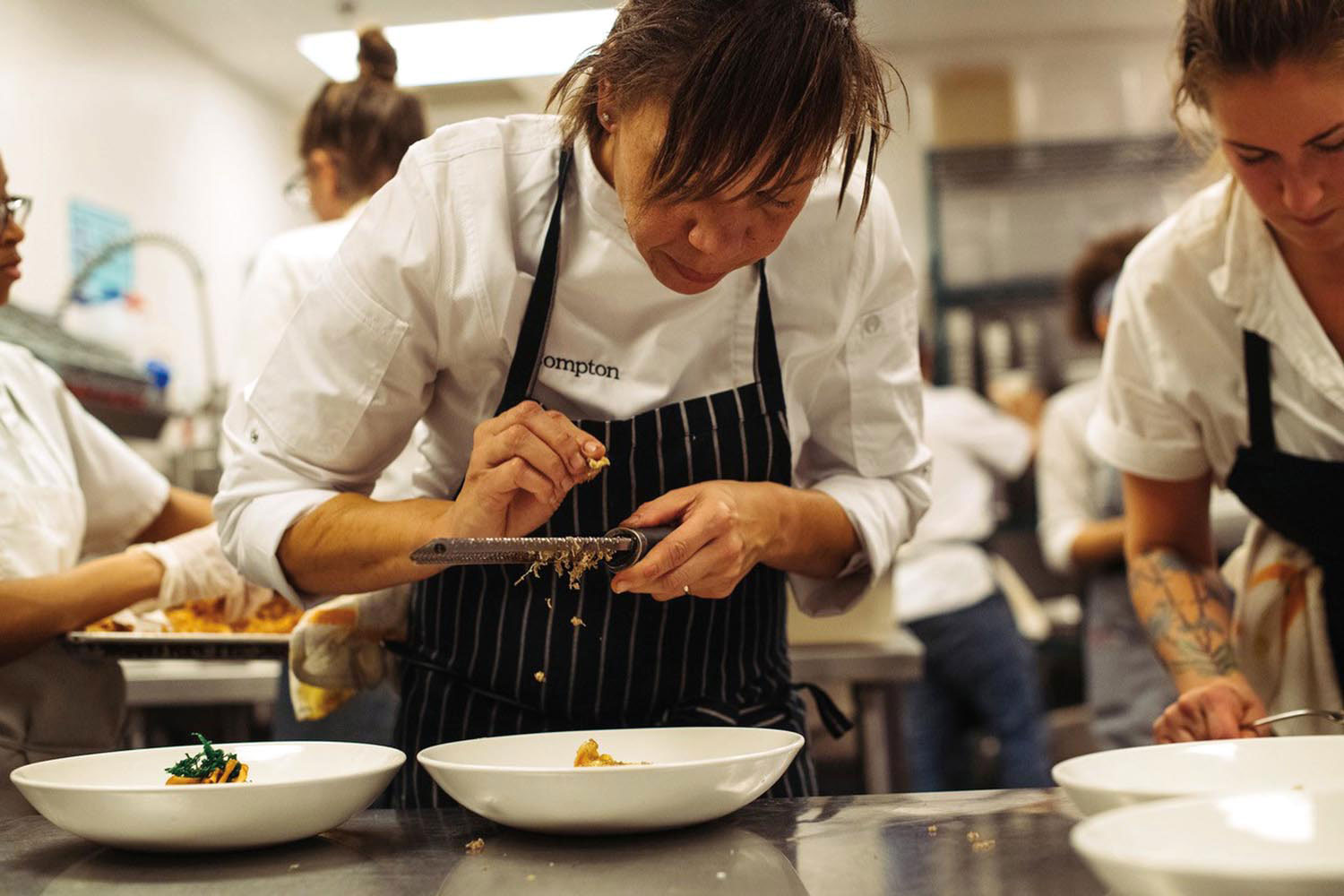 Nina Compton at work in the kitchen at Compère Lapin. Photo by Denny Culbert, courtesy Nina Compton