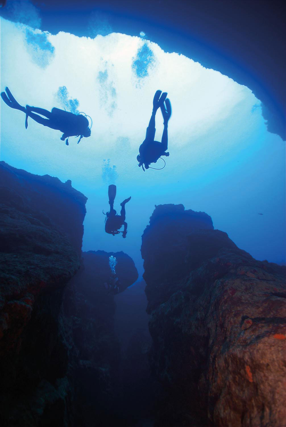 Exploring the deeper reaches of one of the blue holes by scuba. Charles Stirling (Diving)/Alamy Stock Photo