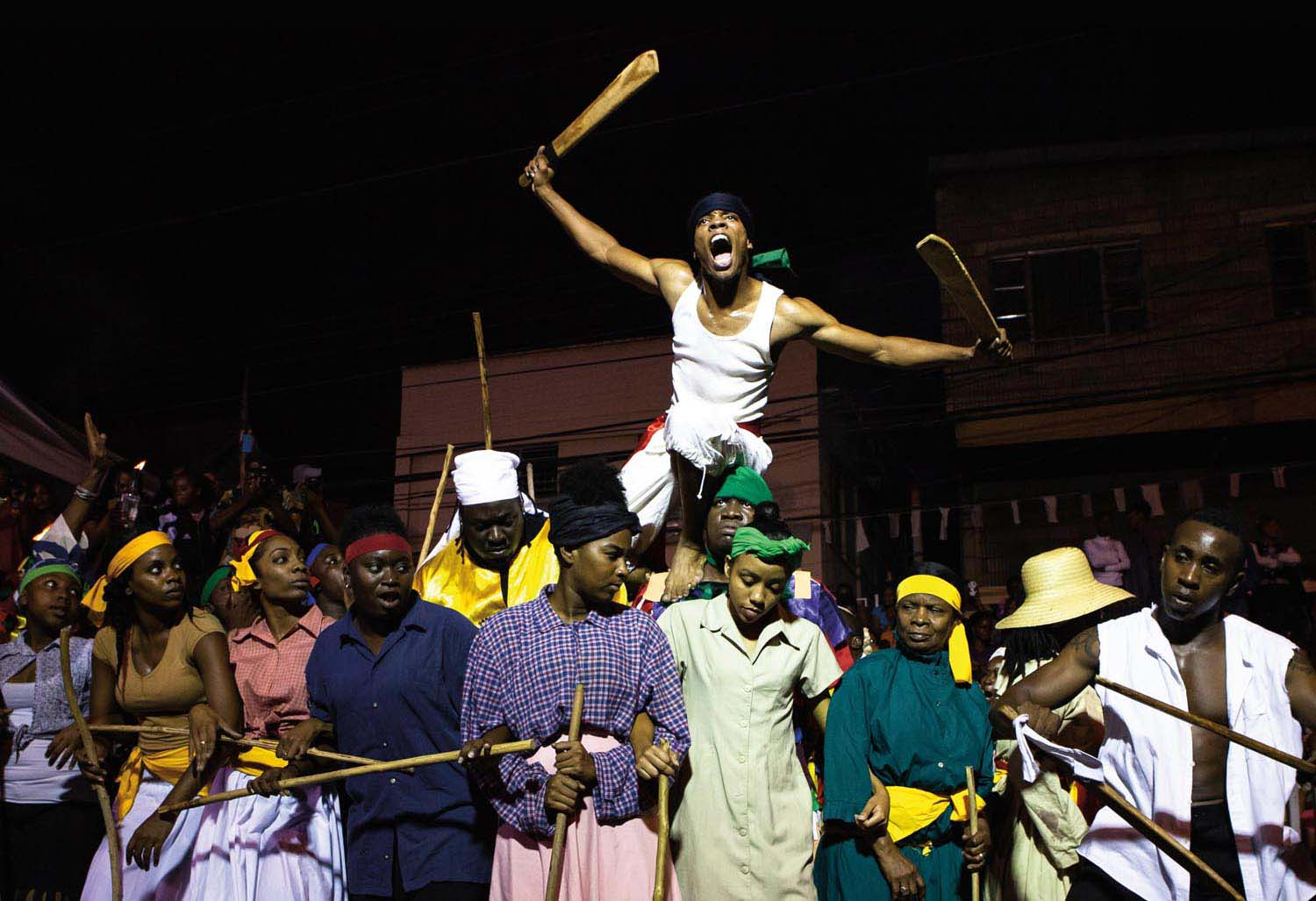 Kambule performers re-enact the beginning of the 1881 Canboulay Riots. Photo by Maria Nunes