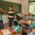 """Students pay attention as Arnold Arupa instructs them in Dutch, the official language of the education system in Suriname. As the principal of the Kananoe primary school in Apetina, he is aware of the educational hurdles indigenous children face. """"I wan"""