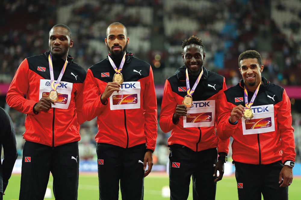 Lalonde Gordon, Machel Cedenio, Jereem Richards, and Jarrin Solomon on the winners' podium at the 2017 World Athletics Championships in London. Photo by Richard Heathcote/Getty Images