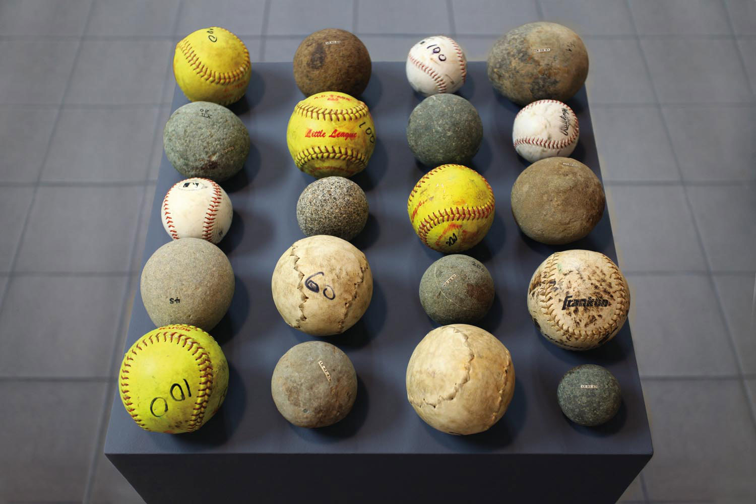 Untitled, Taino lithic crushing tools, softballs, baseballs (2016; collection of Centro León). Made during a residency in the Dominican Republic, this installation juxtaposes prehistoric artefacts with used baseballs that hint at historic US cultural dom