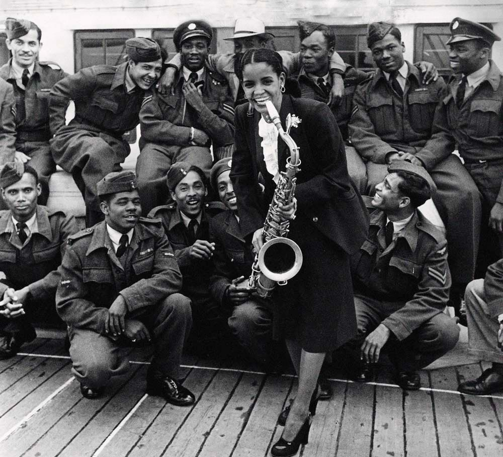 Trinidadian singer Mona Baptise arrives in Britain on the Empire Windrush, June 1948. Photo by Trinity Mirror/Mirrorpix/Alamy Stock Photo