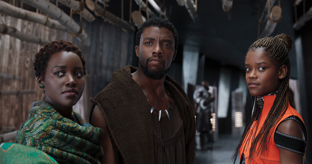 Letitia Wright with her Black Panther co-stars Lupita Nyong'o and Chadwick Boseman. © Marvel Studios 2018