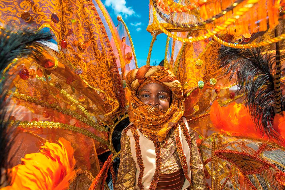 The young revellers of Kiddies' Carnival portray some of the festival's most elaborate visual fantasies with innocent enthusiasm. Photo by Jason Audain