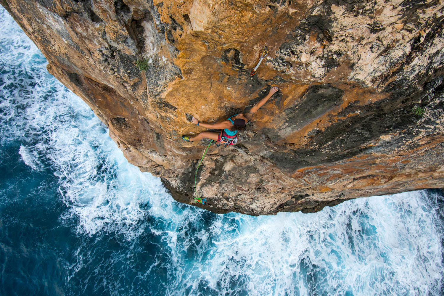 The sea cliffs of Cayman Brac offer an exhilarating climbing experience. Photo by Andrew Burr, courtesy Rock Iguana