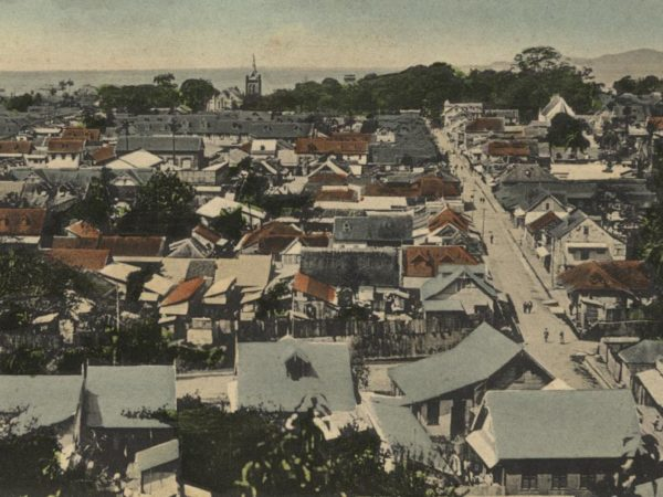 Eastern downtown Port of Spain from the Laventille Hills, in the cocoa boom era. Prince Street leads to Brunswick (later renamed Woodford) Square, with Trinity Cathedral to the left. Postcard published by G.G. Belgrave. Courtesy Historymiami Museum/Stephen Stuempfle