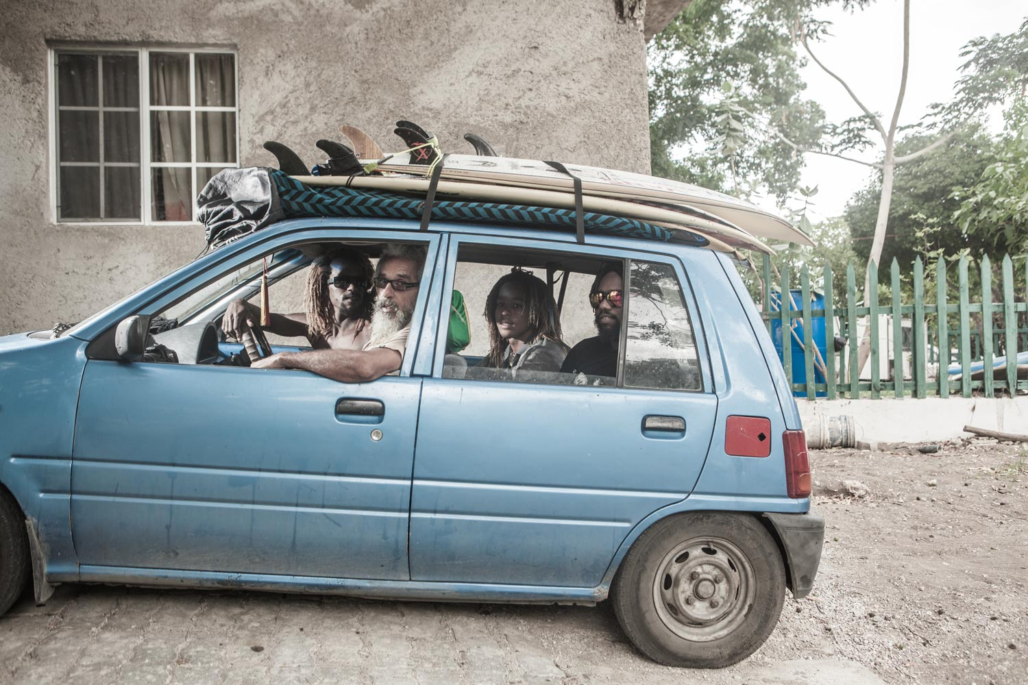 The Wilmots head out to catch some waves: Icah behind the wheel, father Billy in the passenger's seat, and sons Ivah and Ishack behind. Photography by Marlon James