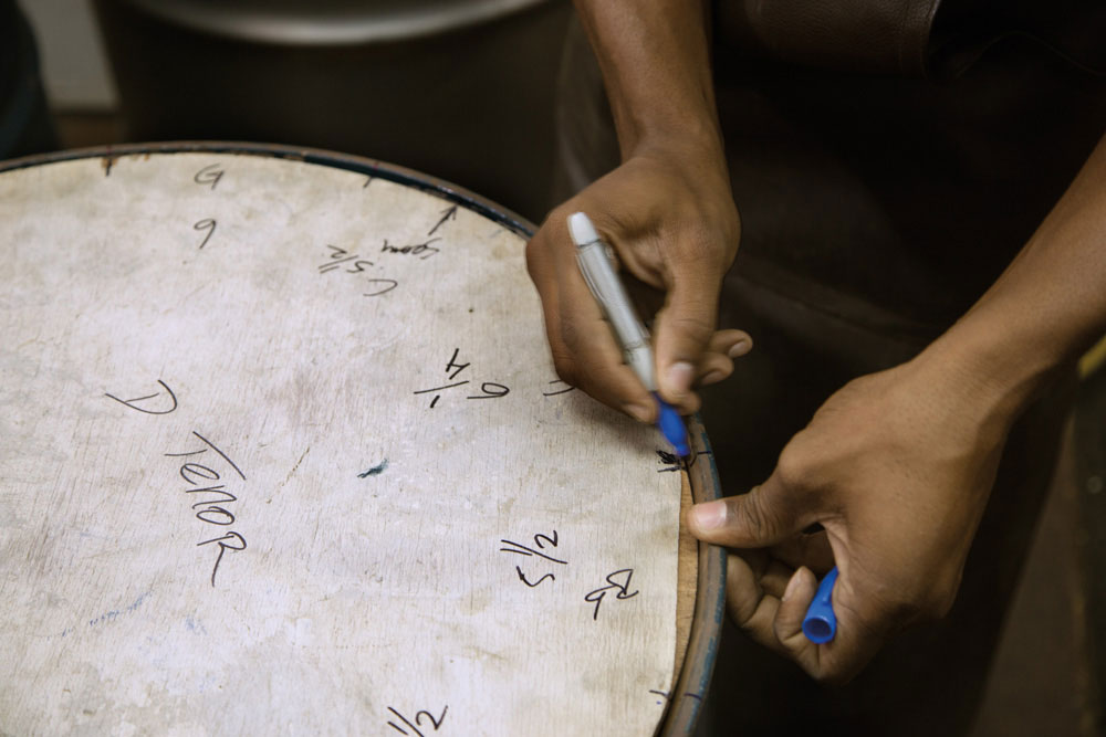Roland Harragin has created templates to mark the segments of each type of drum. This one will become a double tenor. Photography by Mark Lyndersay