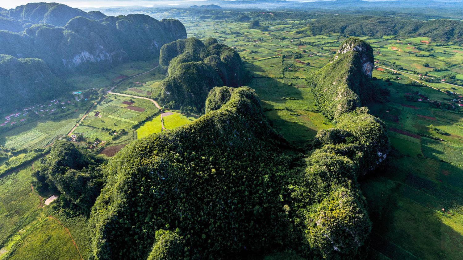 Cuba's Viñales Valley is famous for its distinctive mogotes, sheer-sided limestone hills rising from a lush plain. Photo courtesy Go Cuba