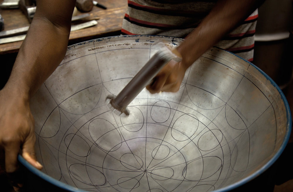 To create the notes on the drum's surface, the metal surrounding each note segment is hammered in, leaving the raised bumps that are responsible for the music. Special care is taken to separate the resonance of each note segment, so that it doesn't bleed into the one next to it. Photography by Mark Lyndersay