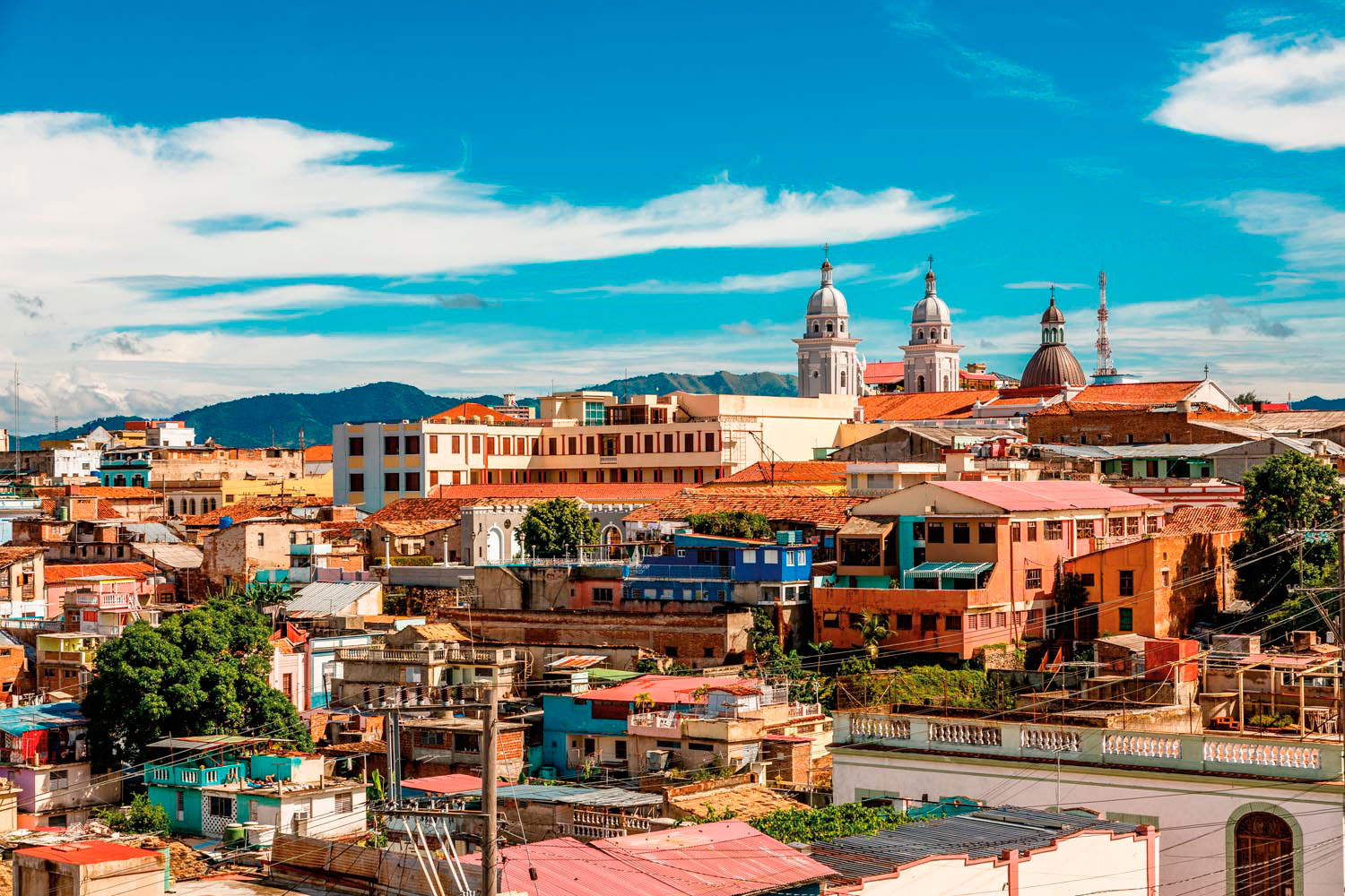 Looking over the rooftops of Santiago de Cuba to the towers of the cathedral. Photo by Vadim Nefedoff/Shutterstock.com