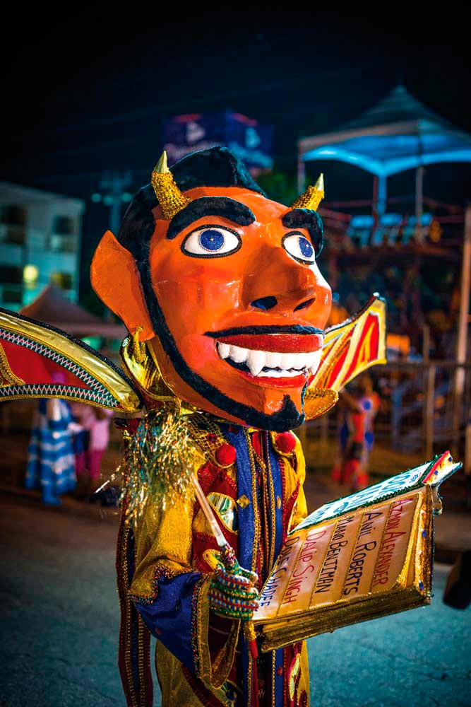 A Bookman, one of T&T Carnival's traditional masquerade characters, with his book purporting to list the names of damned souls. Photo by Jason Audain