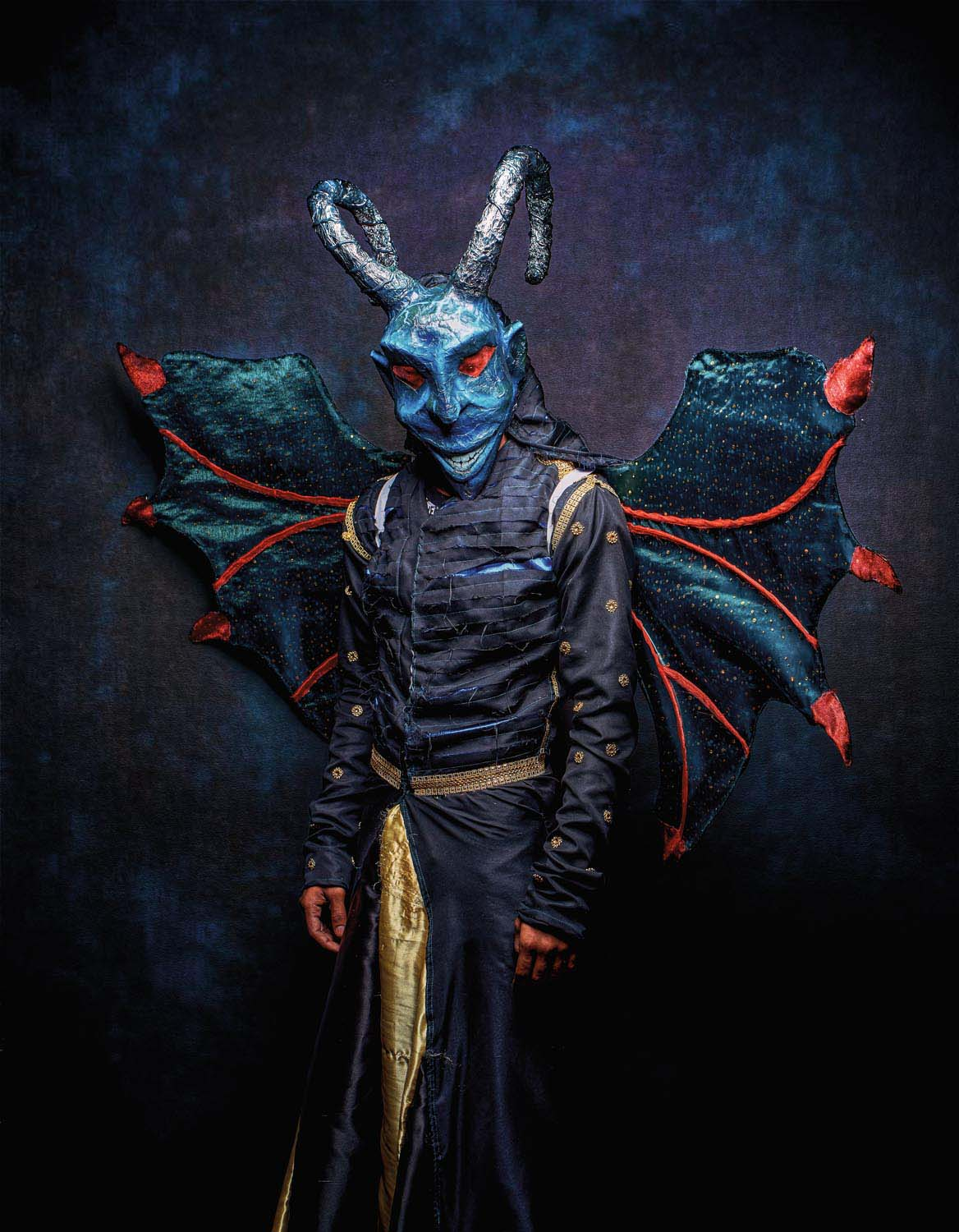 Wicked grin, curving horns, red-tipped wings: Nemai Ali's character Satan is a longtime mainstay in traditional devil mas. Part of the band Gulf Inferno, produced by visual arts students at the University of the West Indies, Ali made his traditional mas