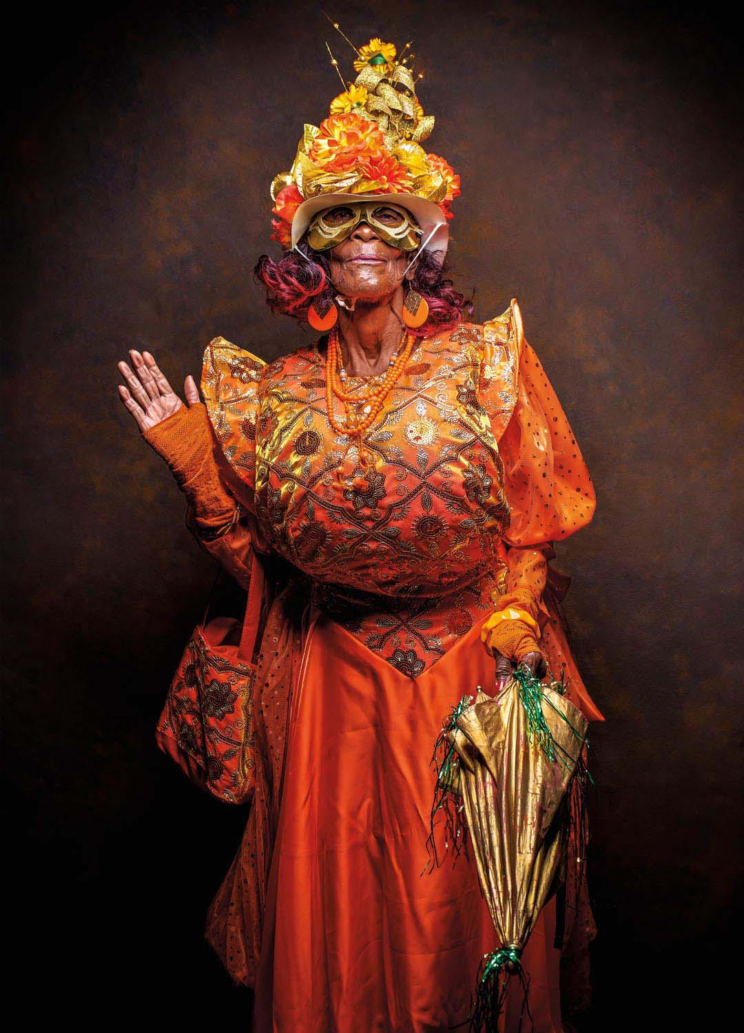 The title of Nelly Joseph's Dame Lorraine presentation, Madame Picong, suggests a tongue as fiery hot as the orange of her costume. Photo Jason C. Audain