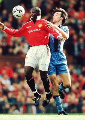Yorke against Coventry's Gary Breen at Old Trafford, 1998