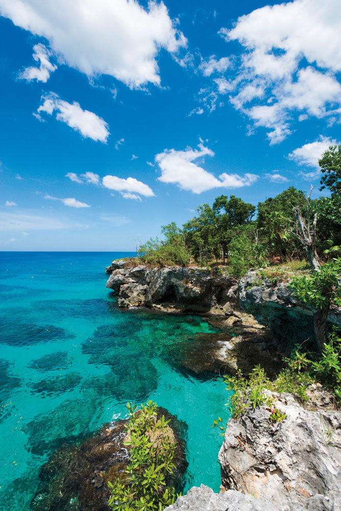 Limestone cliffs mark Jamaica's westernmost tip, close to Negril. Photo by Ian Dagnall/Alamy Stock Photo