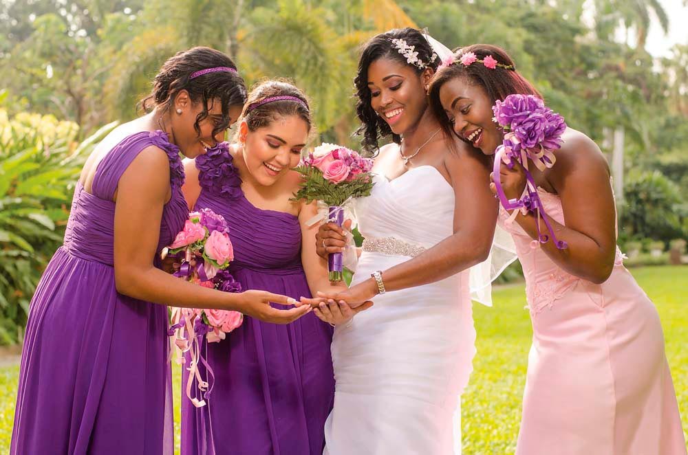 That diamond sparkles even brighter under the golden Jamaican sun. Syrece Francis and her bridesmaids Monique Donaldson, Keisha Amato, and Marsha-Lee Hutchinson share the excitement in Kingston's Hope Gardens. Photo by Kason Stephenson/Kase Studios