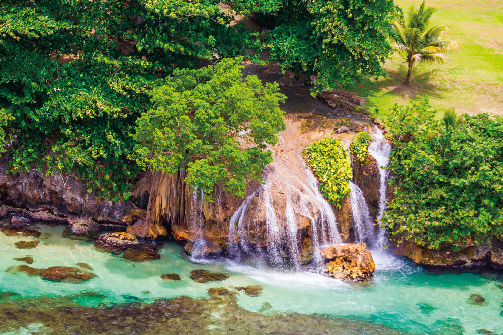 Fresh water meets salt near Ocho Rios on the north coast, as a small river plunges into the crystal sea. Photo by National Geographic Image Collection/AlamyStock Photo
