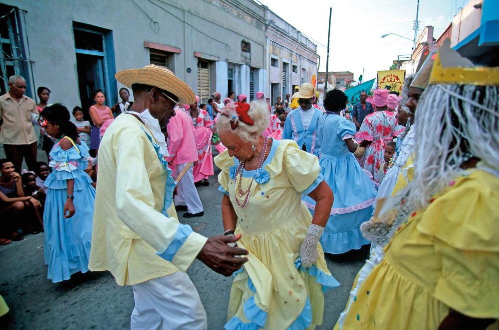 Dancers of all ages join the street procession. Photo by Hemis/Alamy Stock Photo