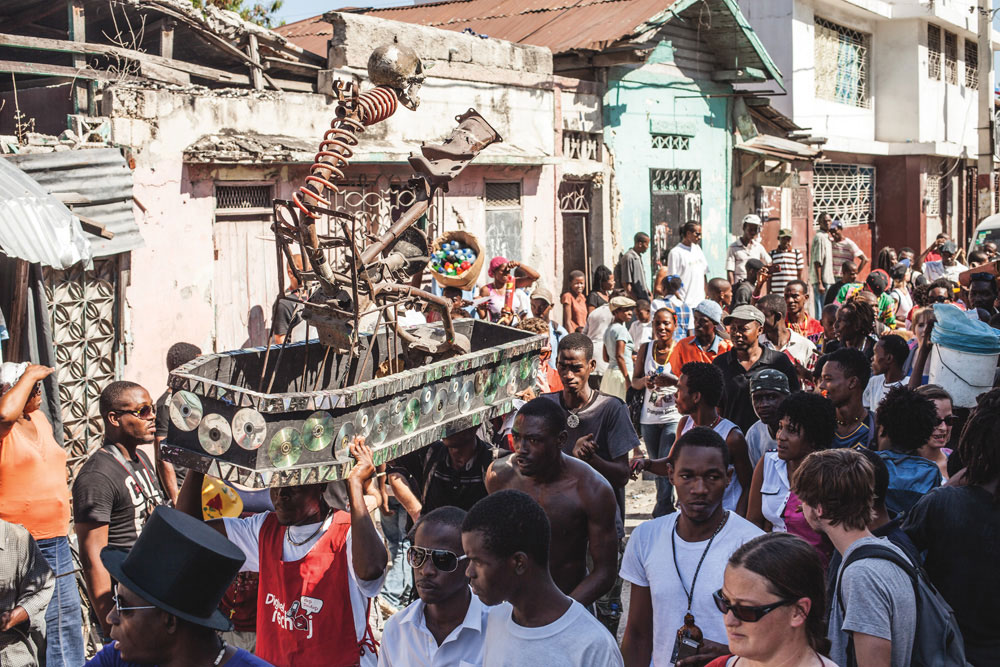 3rd Ghetto Biennale, 2013: street procession with sculpture by André Eugène. Photo by Lazaros, courtesy Ghetto Biennale
