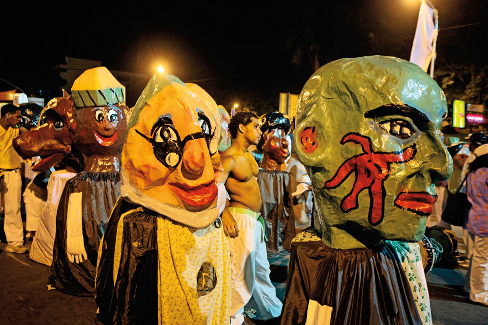 Another distinctive sight: Muñecones with their giant heads of papier-mâché. Photo by Age Fotostock/Alamy Stock Photo