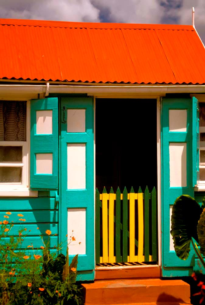 A traditional Nevis cottage, painted in bright colours. Photo by M. Timothy O'Keefe / Alamy Stock Photo