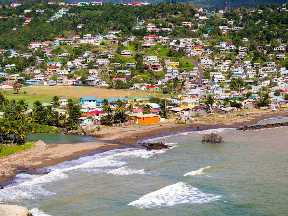 The village of Dennery perches on a hillside along St Lucia's Atlantic coast. Westend61 GmbH / Alamy Stock Photo