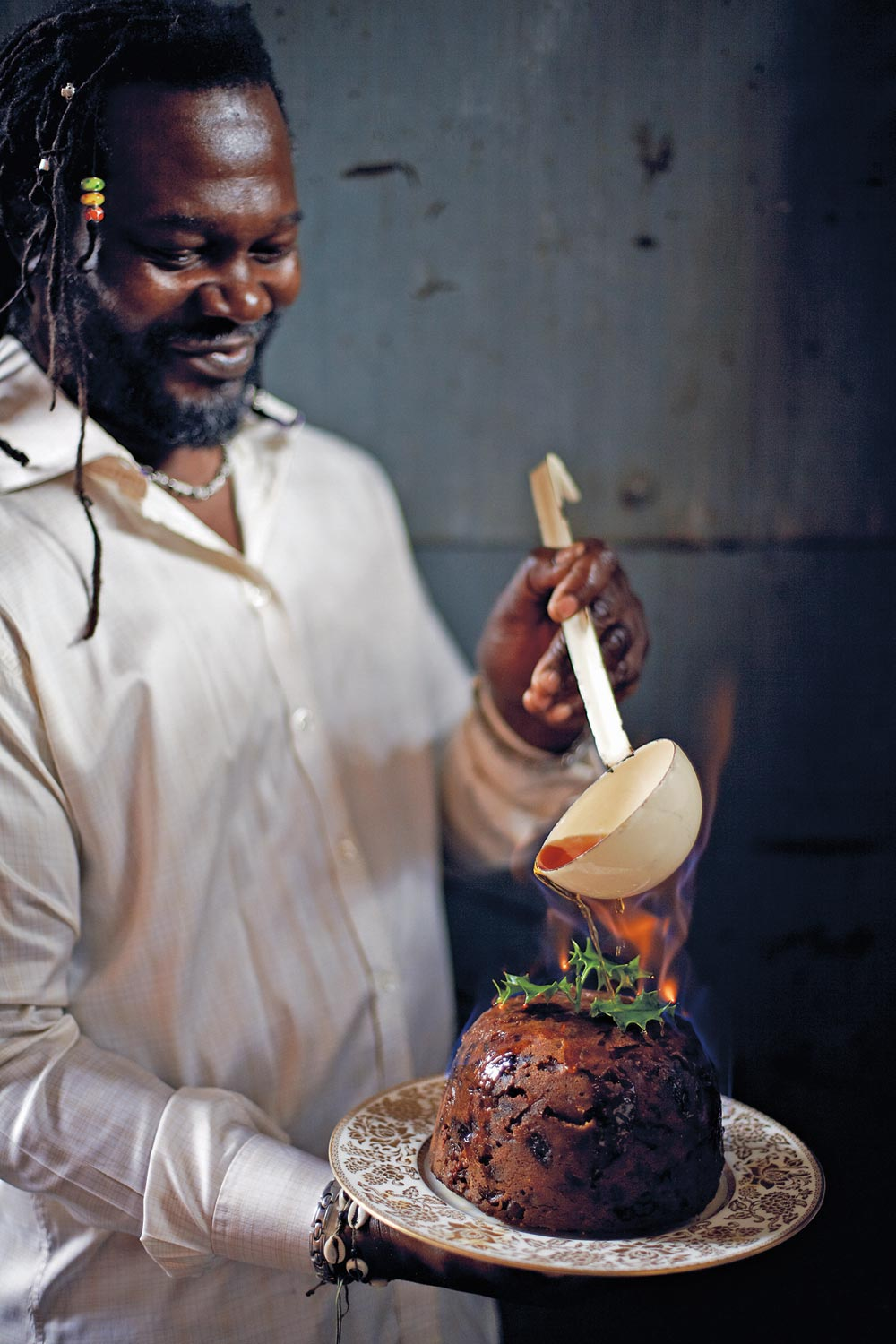 Levi Roots fires a traditional English Christmas pudding. Photograph by Chris Terry