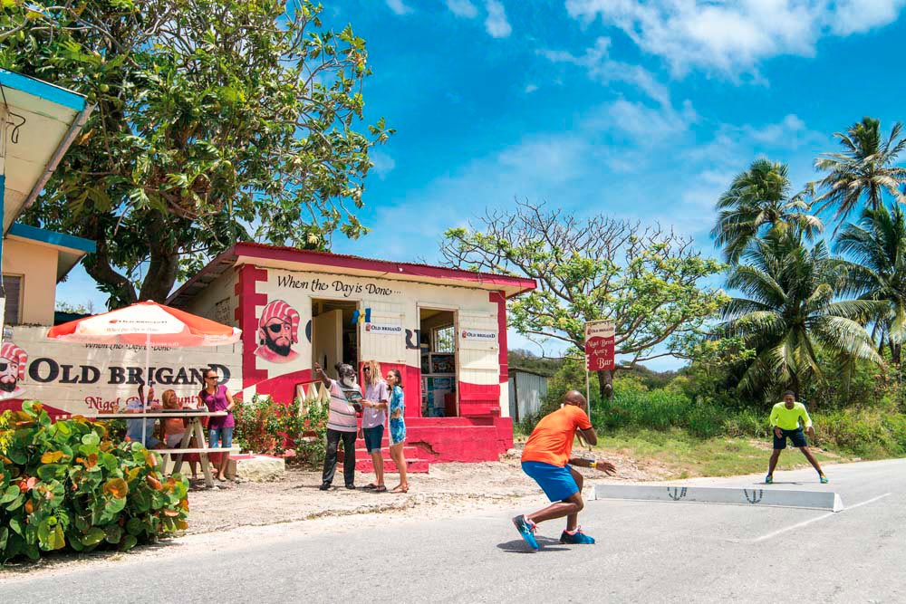 At a traditional rum shop, you can work up a thirst playing a game of road tennis. Photo courtesy Barbados Tourism Marketing Inc
