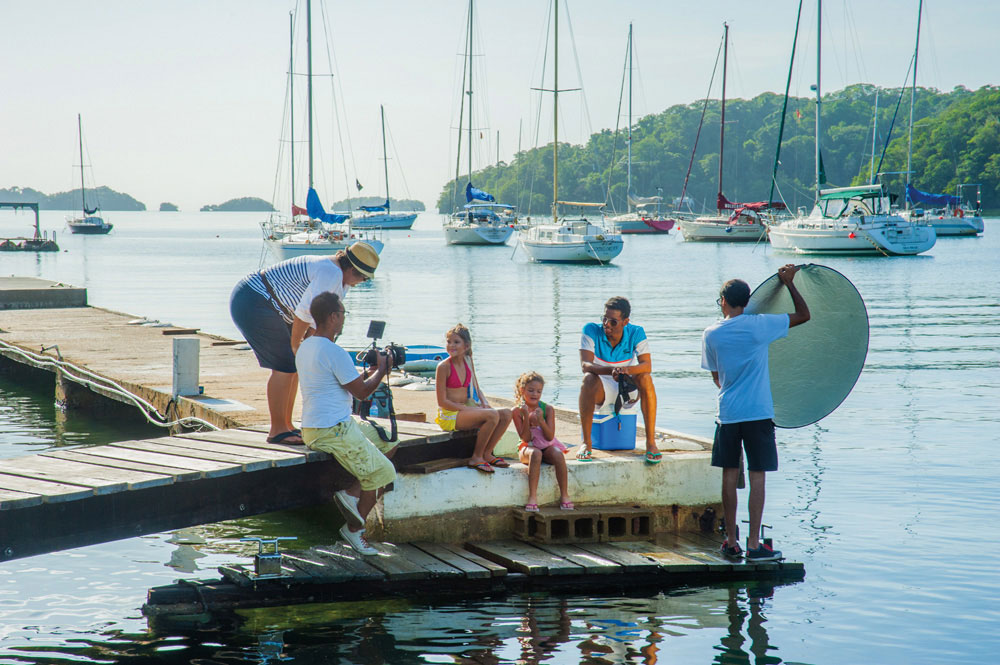 Unfinished Sentences cast and crew filming a scene at the Trinidad Yachting Association. Photography courtesy Savant Films