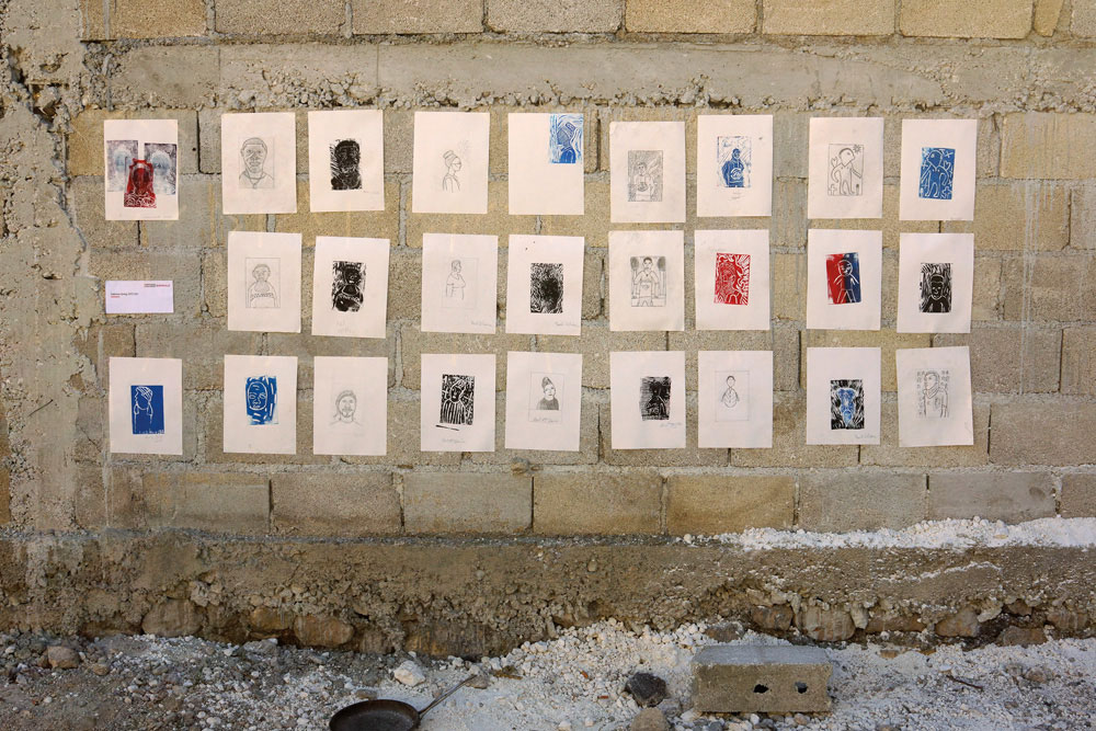 """5th Ghetto Biennale, 2017: works from Potre, a collaborative printmaking workshop with artist and curator Sabrina Greig and members of Ti Moun Rezistans, the youth arm of Atis Rezistans, exploring """"self-portraiture and printmaking as a method of emancipation and radical self-love"""". Photo by Laura Heyman, courtesy Ghetto Biennale"""