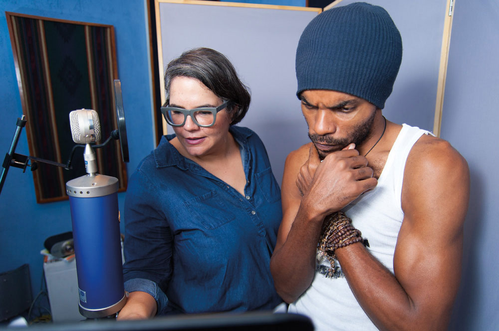 Filmmaker Mariel Brown and voice actor Nikolai Salcedo in the recording studio. Photography courtesy Savant Films