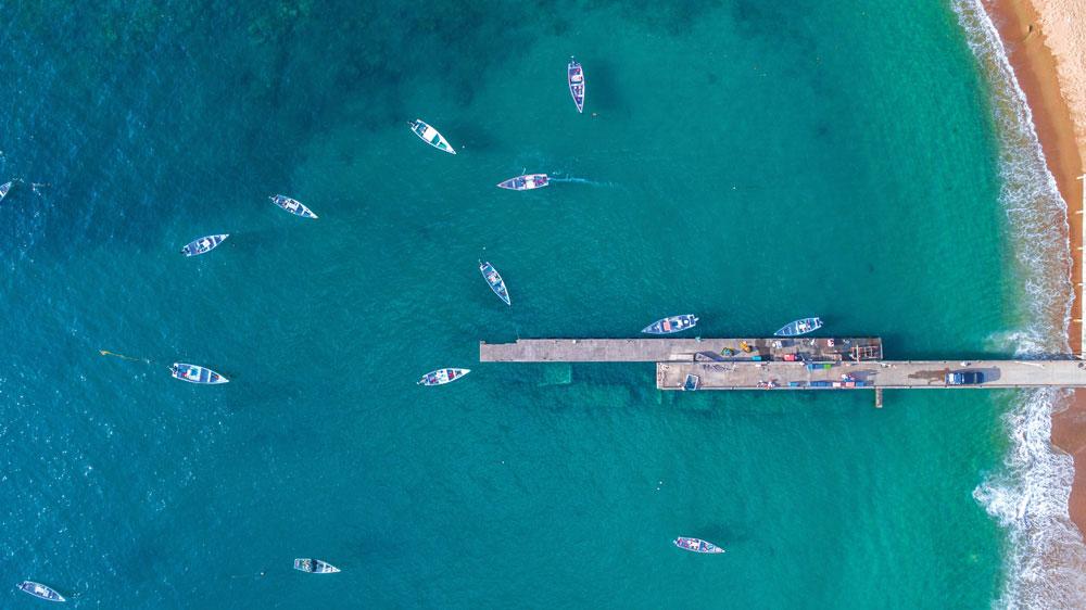 The brilliant blue waters of Parlatuvier Bay. Photo by Michaela Arjoon