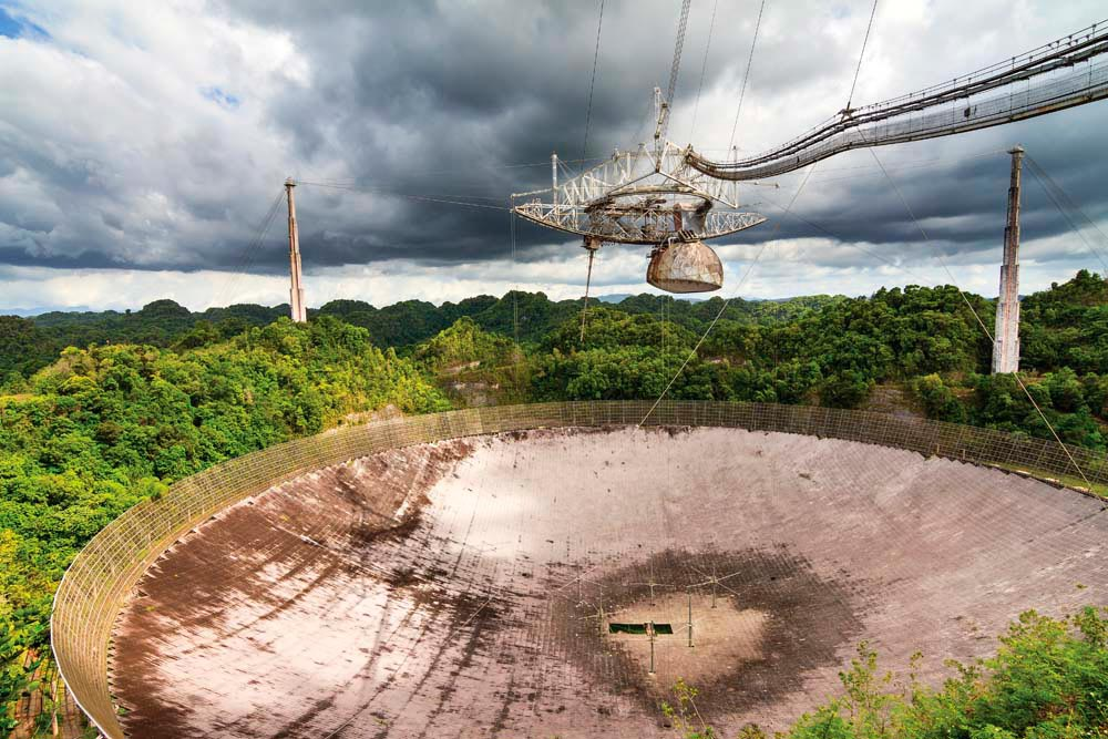 Opened in 1963, the radio telescope at Arecibo was the world's largest for almost five decades. Photo by Dennis van de Water / Shutterstock.com
