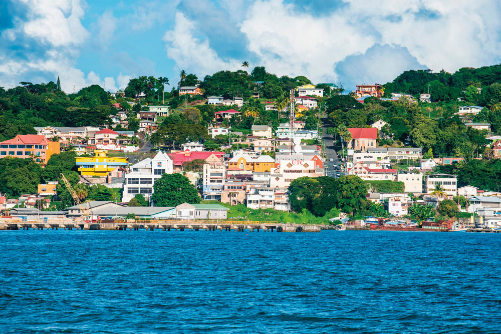 The houses of Scarborough ascend their hill overlooking the harbour. Photo by Robertharding/Alamy Stock Photo