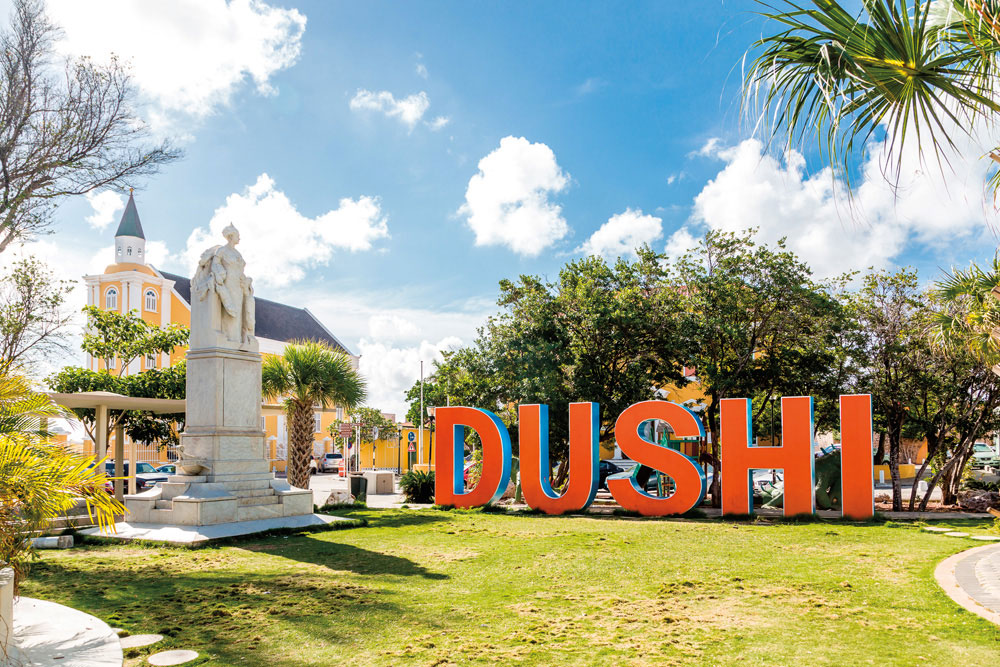 """At the centre of Willemstad, giant letters spell out the Papiamentu word """"Dushi""""— a perfect selfie location. Photo by Darryl Brooks/Shutterstock.com"""
