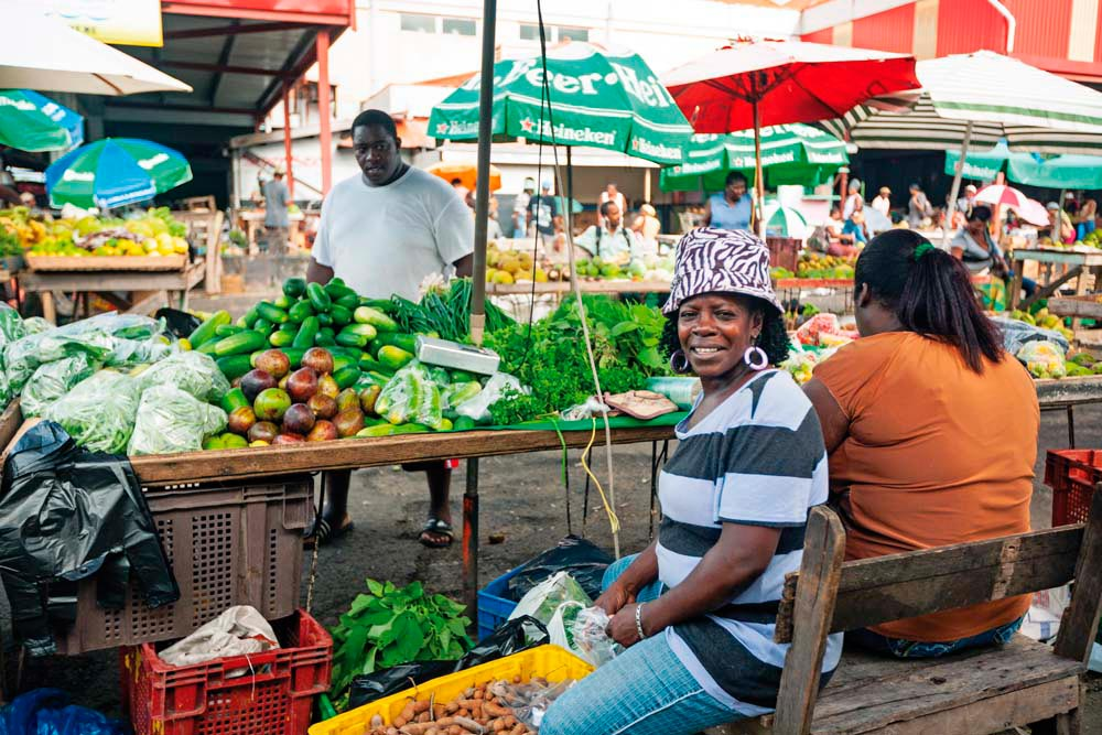 At the heart of Castries, St Lucia's intimate capital, is the historic market — the place to come for fresh produce, charming craftwork, and vendors' welcoming banter (#fresh #buylocal #goodmorning). Photo by Danielle Devaux