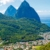 The most iconic view of St Lucia: the twin Pitons, their steep slopes covered in lush forest, rising above the picturesque town of Soufrière (#whataview #breathtaking #headforheights). Photo by Michael Murray/Alamy Stock Photo