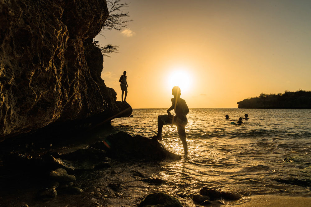 A sunset swim at Daaibooi Bay. Photo by Gail Johnson/Shutterstock.com